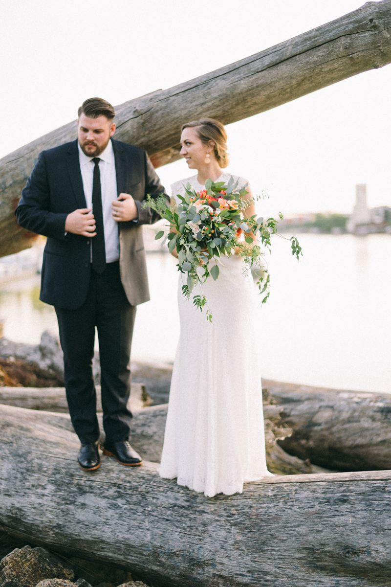Bride and Groom on driftwood at Minnesota Boat Club