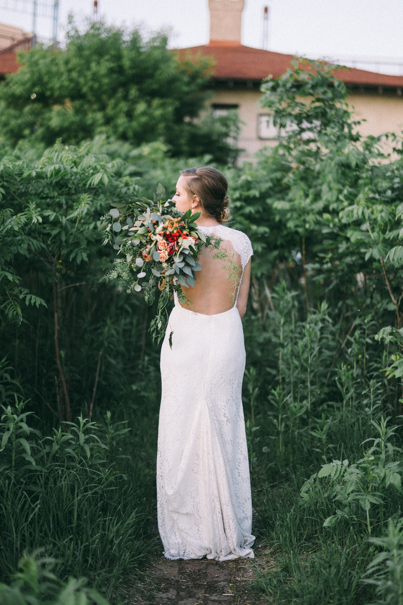 Bride with bouquet in st paul woods